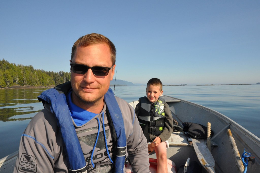 Ryan with his son in a boat.